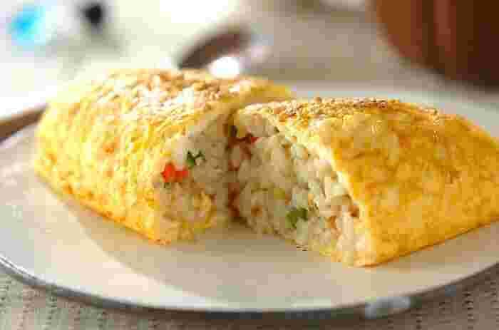 カニ缶、ニンジン、サヤインゲン、白ネギ、ショウガ、卵などで作る、ちょっと珍しい中華味のオムライス。味付けも 中華スープの素や、塩こしょうなどでシンプルですが、何もつけなくても、カニの風味たっぷりの美味しい仕上がりになり、大満足♪