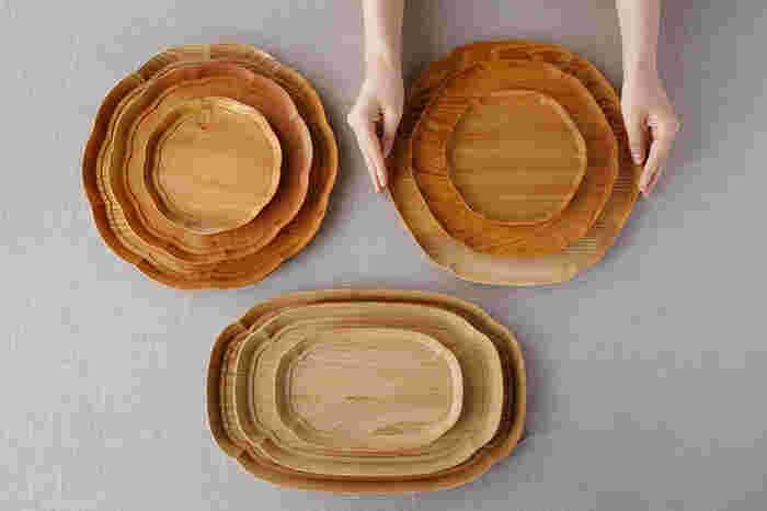 石川県輪島市の「四十沢(あいざわ)木材工芸」と、デザイナーの大治将典氏のコラボで誕生した「KITO」シリーズ。「木の麗しさ」を日常に提供することを目標としてはじまったシリーズ。左上から時計回りに「輪花盆」、「雪輪盆」、「長木瓜盆」の三種類三サイズあり、どれもくるみオイルだけを使って仕上げられているので、木材の美しい佇まいがとても魅力的。