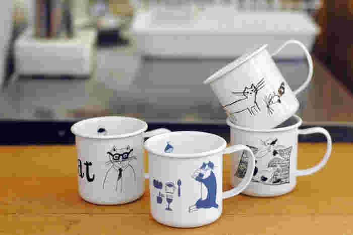 「旅するレストラン・トラネコボンボン」を主宰している料理人・中西なちおさんのイラストが描かれた琺瑯製のマグカップです。色やニオイがつきにくい素材なので、デイリーに扱いやすいのが特徴。ゆるさとちょっぴりレトロな雰囲気をあわせ持った、不思議な空気感のイラストが、心をほっと癒してくれます。
