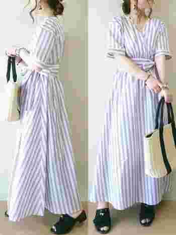 爽やかなカシュクールタイプのストライプワンピースは、ウエストマークでスタイルをよく見せてくれます。Aラインのスカートの広がりが女性らしいですね。